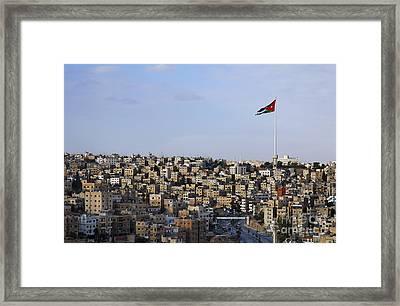 Jordanian Flag Flying Over The City Of Amman Jordan Framed Print by Robert Preston