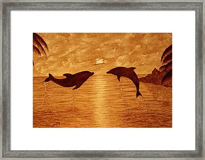 Jumping Dolphins At Sunset Framed Print by Georgeta  Blanaru