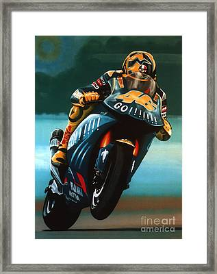 Jumping Valentino Rossi  Framed Print by Paul Meijering