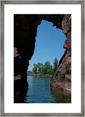 Kayaking Through The Arch Framed Print by Sandra Updyke