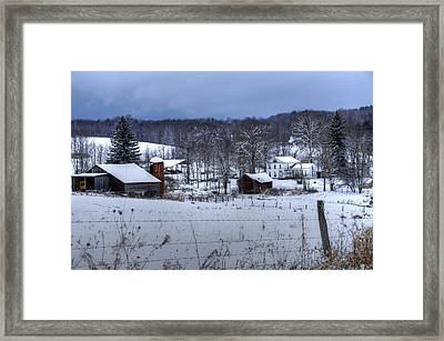 Keeping Warm Framed Print by David Simons