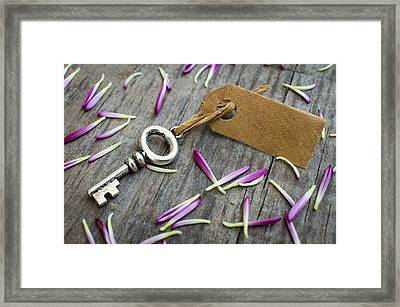 Key With A Label Framed Print by Aged Pixel