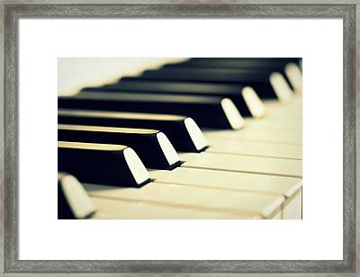 Keyboard Of A Piano Framed Print by Chevy Fleet