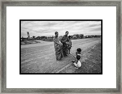 Khmer Rouge Monks Framed Print by David Longstreath