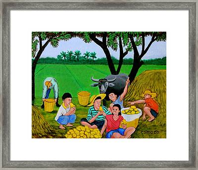 Kids Eating Mangoes Framed Print by Cyril Maza