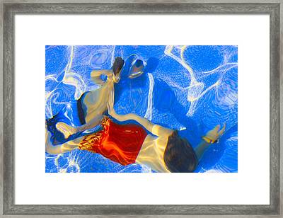 Kids Swimming Underwater Framed Print by Don Hammond