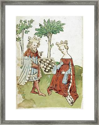 King And Queen Playing Chess Framed Print by British Library