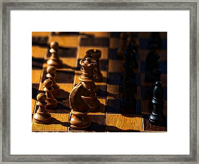 Knight Takes Bishop Framed Print by Camille Lopez
