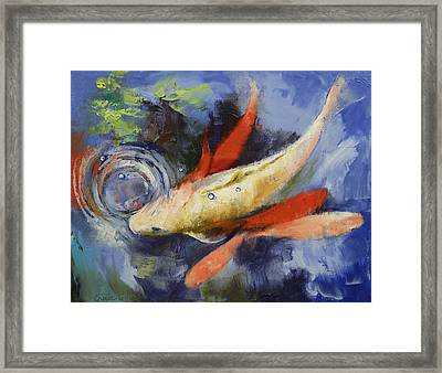 Koi And Water Ripples Framed Print by Michael Creese