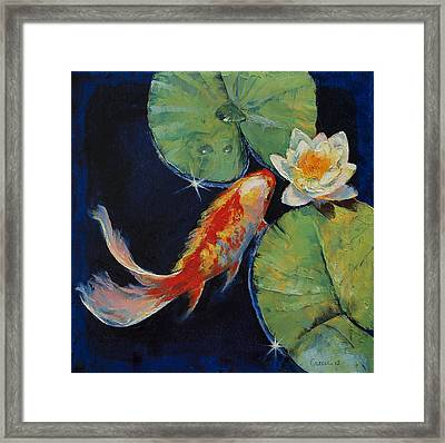 Koi And White Lily Framed Print by Michael Creese