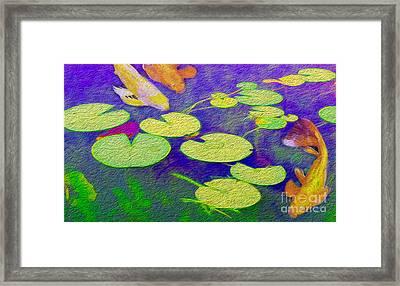 Koi Fish Under The Lilly Pads  Framed Print by Jon Neidert