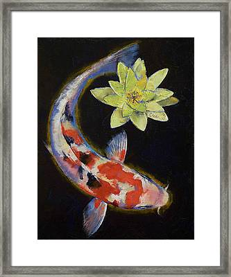 Koi With Yellow Water Lily Framed Print by Michael Creese