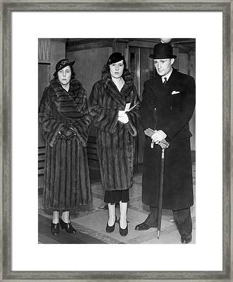 Lady Furness Assist In Custody Framed Print by Underwood Archives