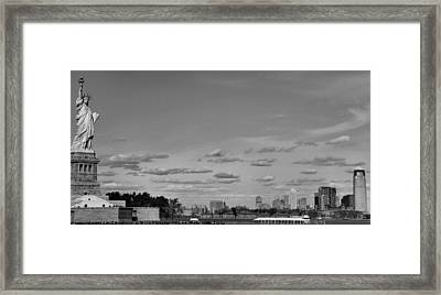 Lady Liberty Watching Over New York City Framed Print by Dan Sproul