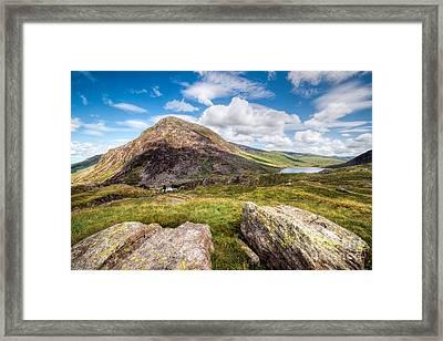 Lake Ogwen Framed Print by Adrian Evans