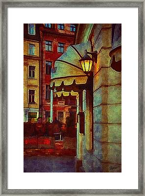 Lantern At The Cafe Framed Print by Gynt