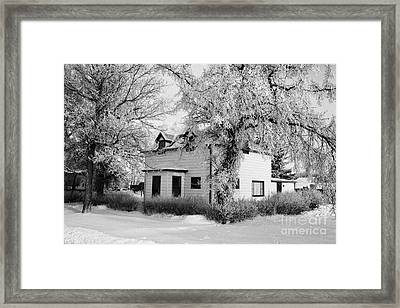 large residential traditional house in rural village Forget Saskatchewan Canada Framed Print by Joe Fox