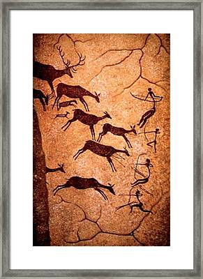 Lascaux Stag Hunting Framed Print by Asok Mukhopadhyay