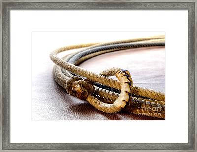 Lasso Hondo Loop Framed Print by Olivier Le Queinec