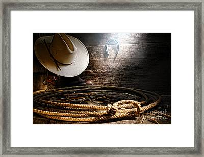 Lasso In Old Barn Framed Print by Olivier Le Queinec