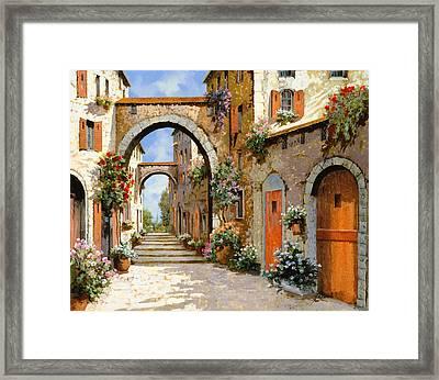 Le Porte Rosse Sulla Strada Framed Print by Guido Borelli