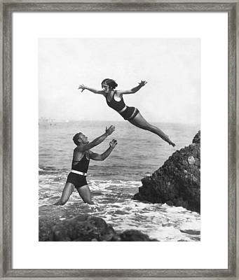 Leap Into Life Guard's Arms Framed Print by Underwood Archives