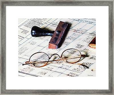 Ledger With Eyeglasses And Rubber Stamp Framed Print by Susan Savad