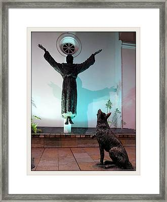 Levitation Saint And  Wolf  Framed Print by Daniel Gomez