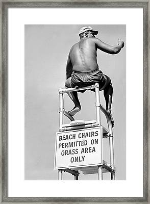 Lifeguard At The Beach Framed Print by Underwood Archives