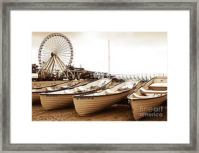 Lifeguard Boats Framed Print by John Rizzuto