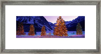 Lighted Christmas Trees, Chateau Lake Framed Print by Panoramic Images