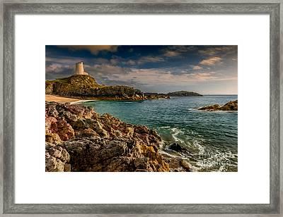 Lighthouse Bay Framed Print by Adrian Evans