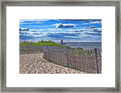 Lighthouse From Afar Framed Print by Trudy Wilkerson