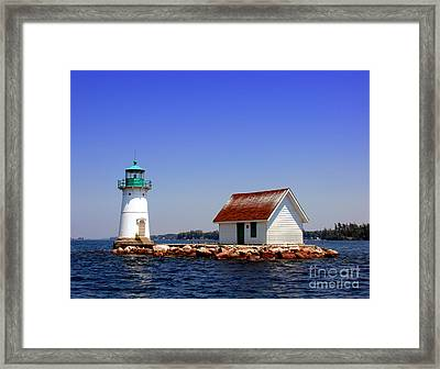 Lighthouse On The St Lawrence River Framed Print by Olivier Le Queinec
