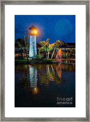 Lighthouse Reflection Framed Print by Adrian Evans