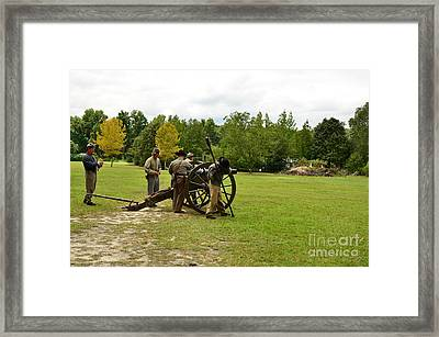 Lighting The Fuse Of A Civil War Canon Framed Print by Bob Sample