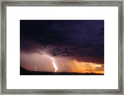 Lightning In A Rain Curtain At Sunset Framed Print by Thomas Wiewandt