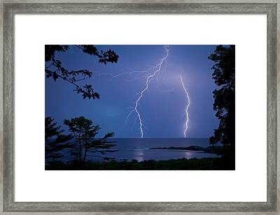 Lightning Over Sea Framed Print by Peter Menzel