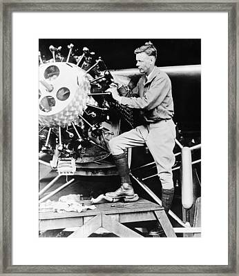 Lindbergh Tunes Up Plane Framed Print by Underwood Archives