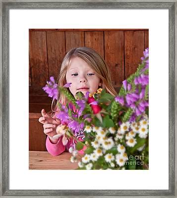 Little Girl Flower Arranging Framed Print by Valerie Garner