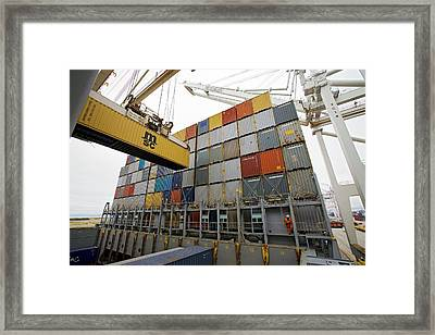 Loading Cargo Containers Framed Print by Jim West