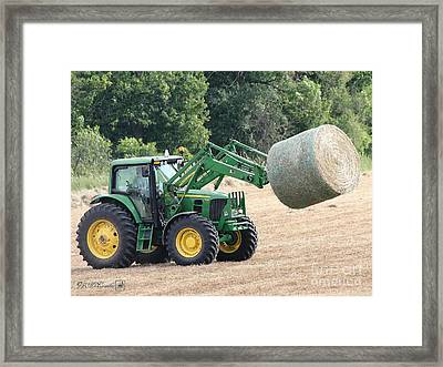 Loading Hay Framed Print by J McCombie