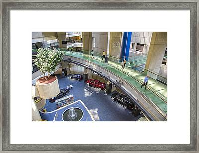 Lobby And Walkway Of Renaissance Center  Framed Print by John McGraw