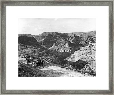 Lone Car In Fish Creek Canyon Framed Print by Underwood Archives