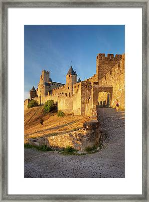 Lone Female Walks Down The Ramp Framed Print by Brian Jannsen