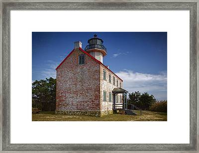 Lonely East Point Lighthouse Framed Print by Joan Carroll