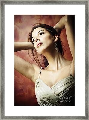 Long Dark Haired Brunette Woman With Brown Eyes Looking Away With Hands Behind Her Head Framed Print by Joe Fox