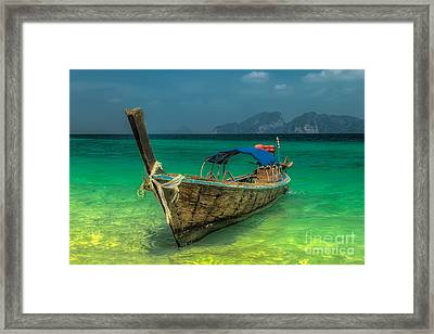 Longboat Framed Print by Adrian Evans