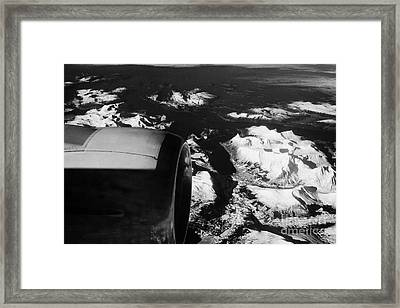 Looking Out Of Aircraft Window Past Engine And Over Snow Covered Fjords And Coastline Of Norway Euro Framed Print by Joe Fox