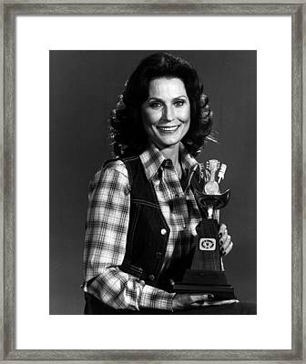 Loretta Lynn With Award Framed Print by Retro Images Archive
